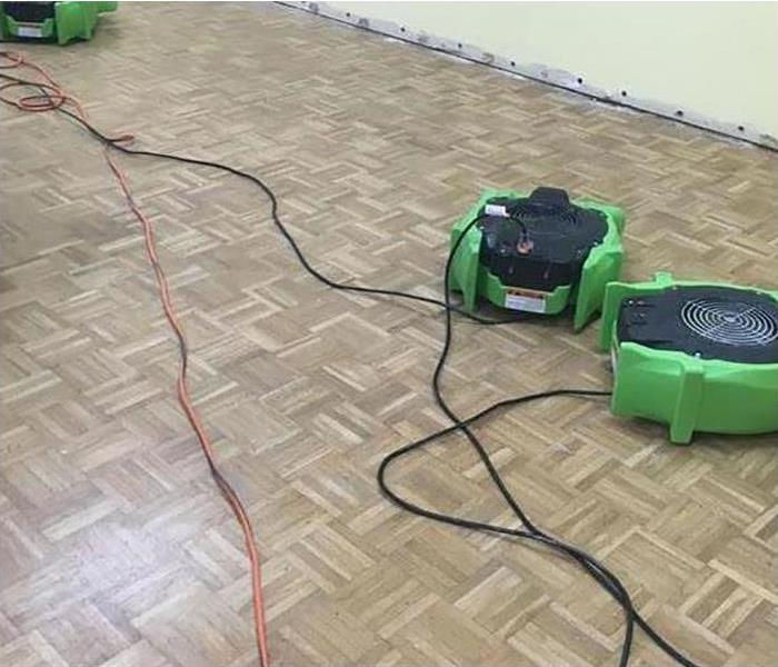 green fans on tile floor