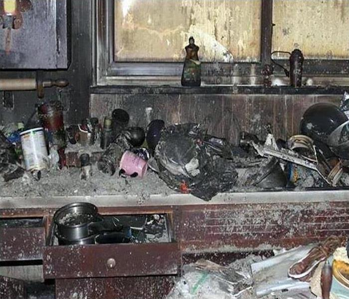 fire damaged kitchen with debris