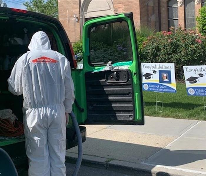 SERVPRO technician in full PPE suit